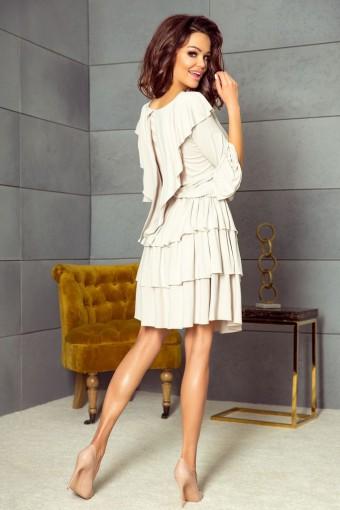 Beżowa sukienka z falbanami