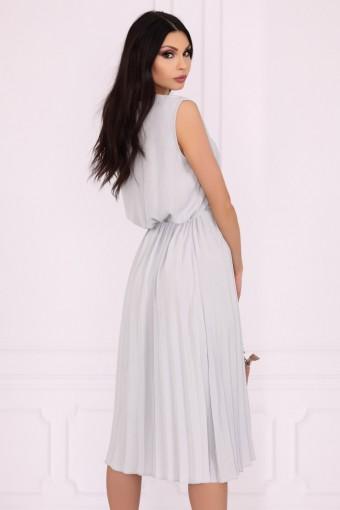 Elegancka sukienka z plisowanym dołem