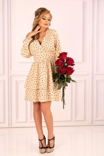 Rozkloszowana sukienka z falbankami kremowa